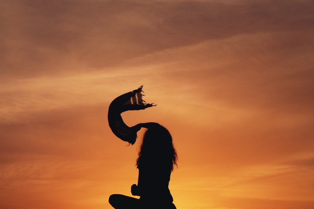 silhouette woman sitting