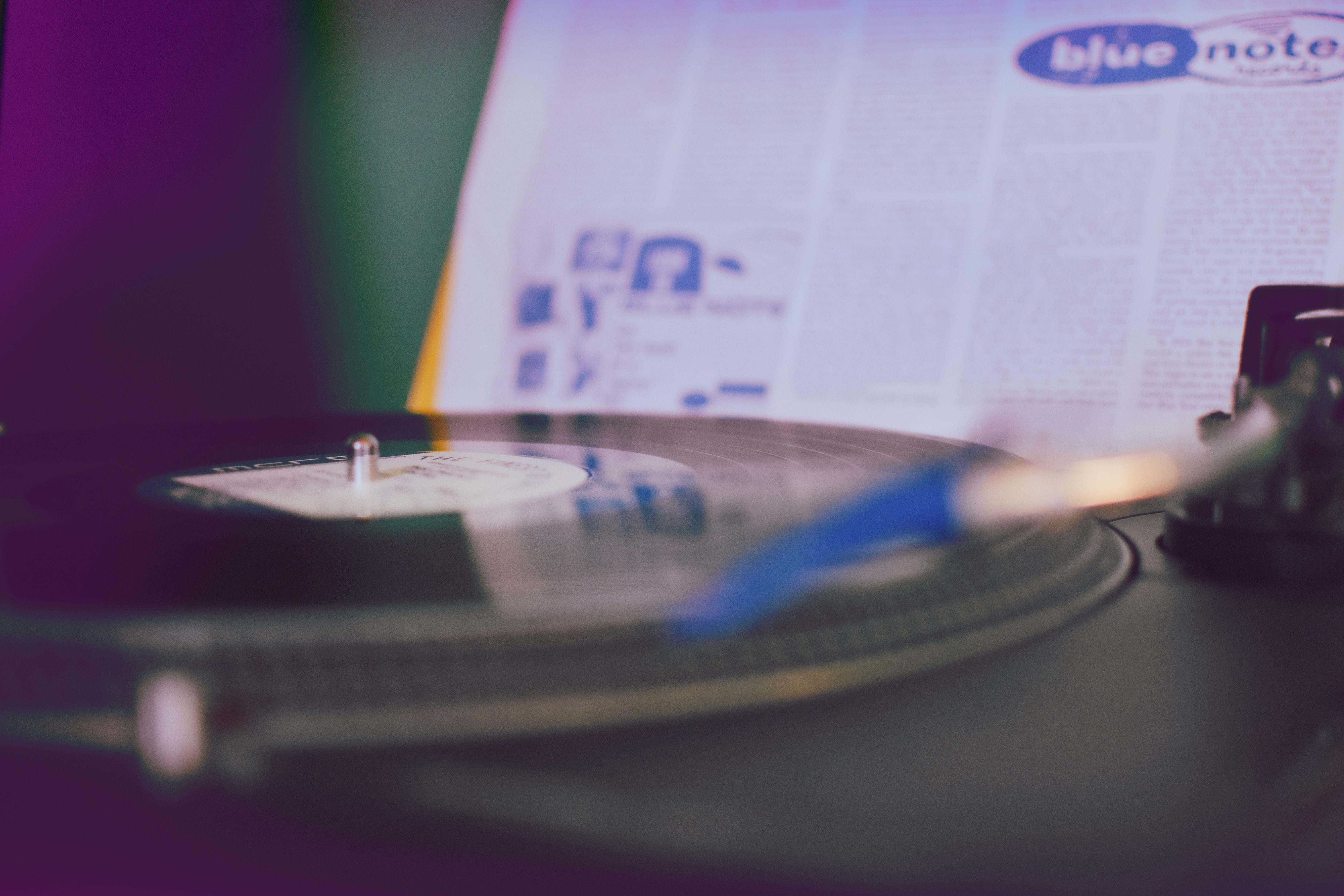 black vinyl player near white paper