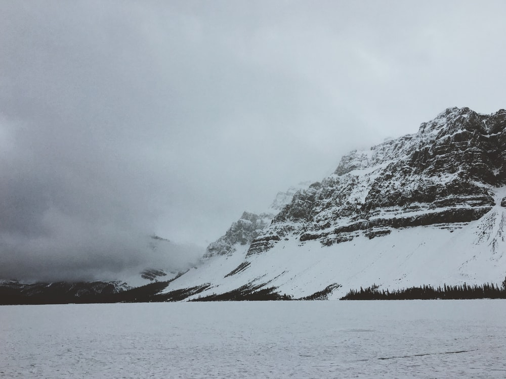 selective focus photography of mountain cover of snow
