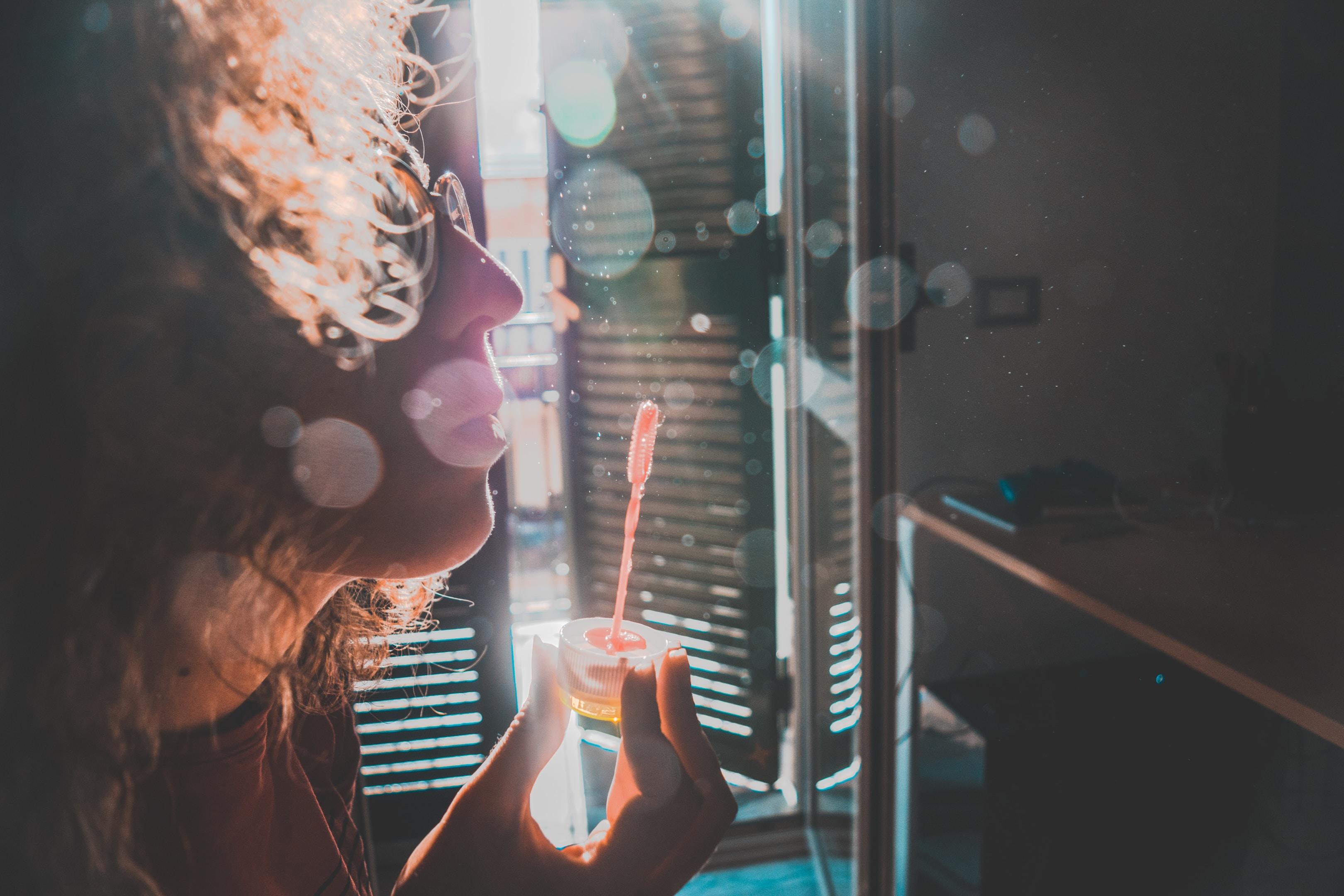 woman making bubble