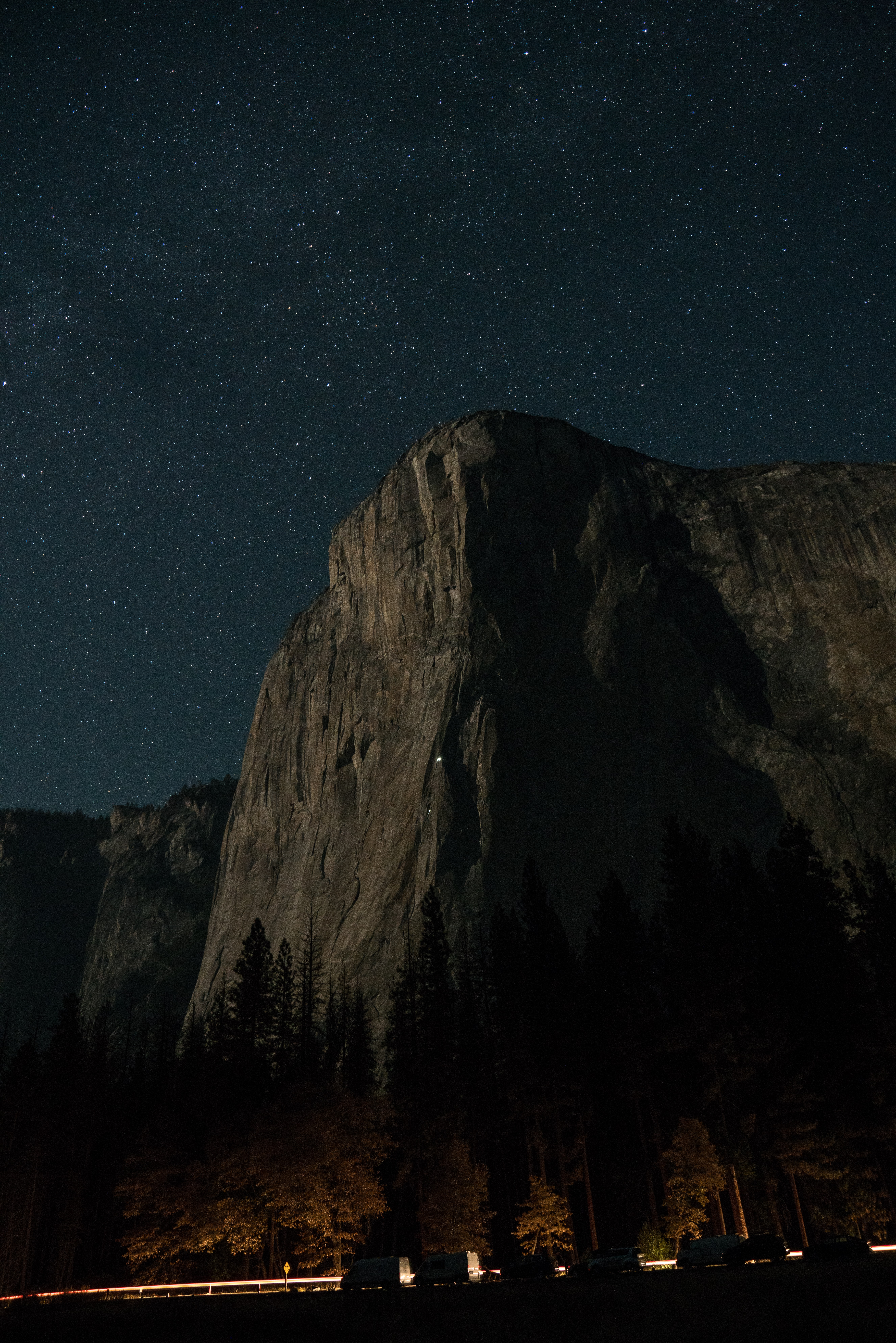 brown mountain cliff with starry sky