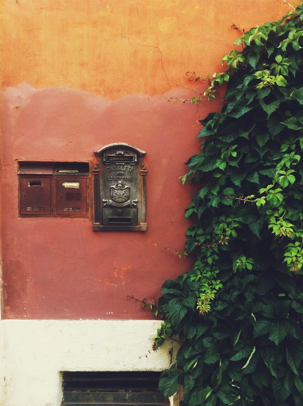 black mailbox on wall