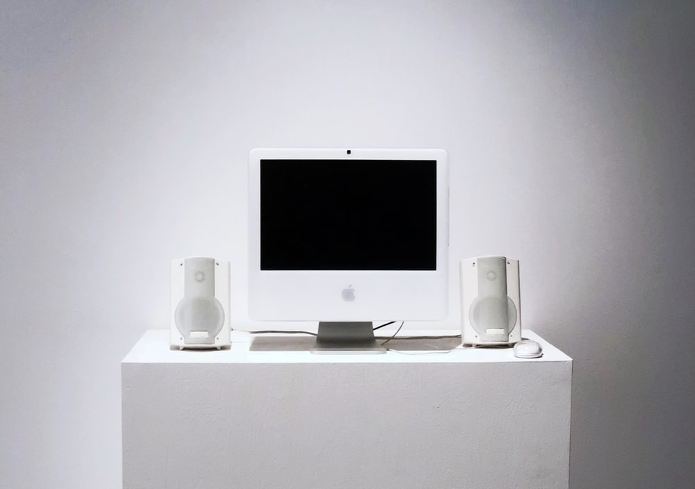 Apple Studio Display monitor on white table