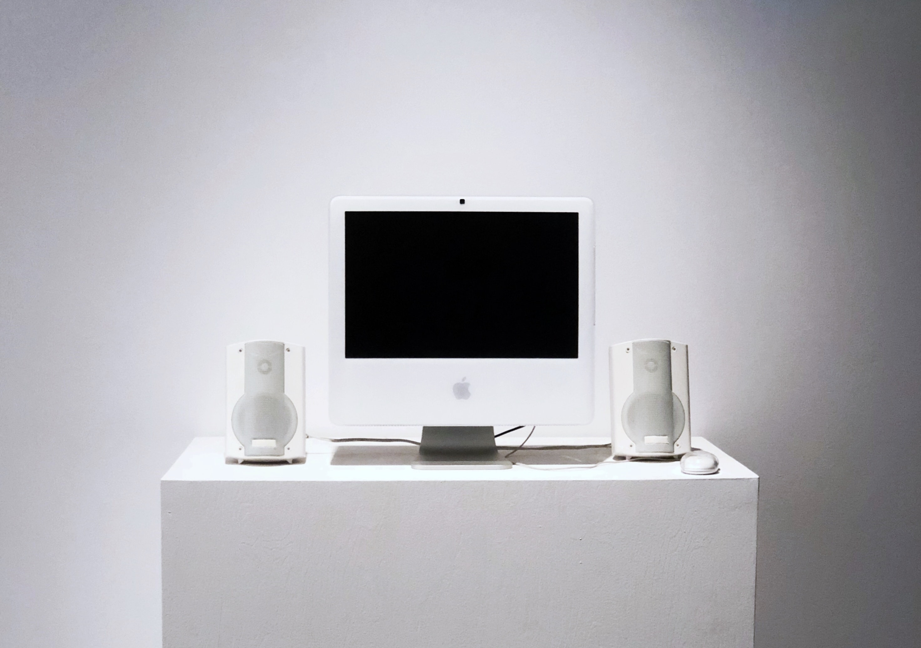 Apple Studio Display monitor on white table
