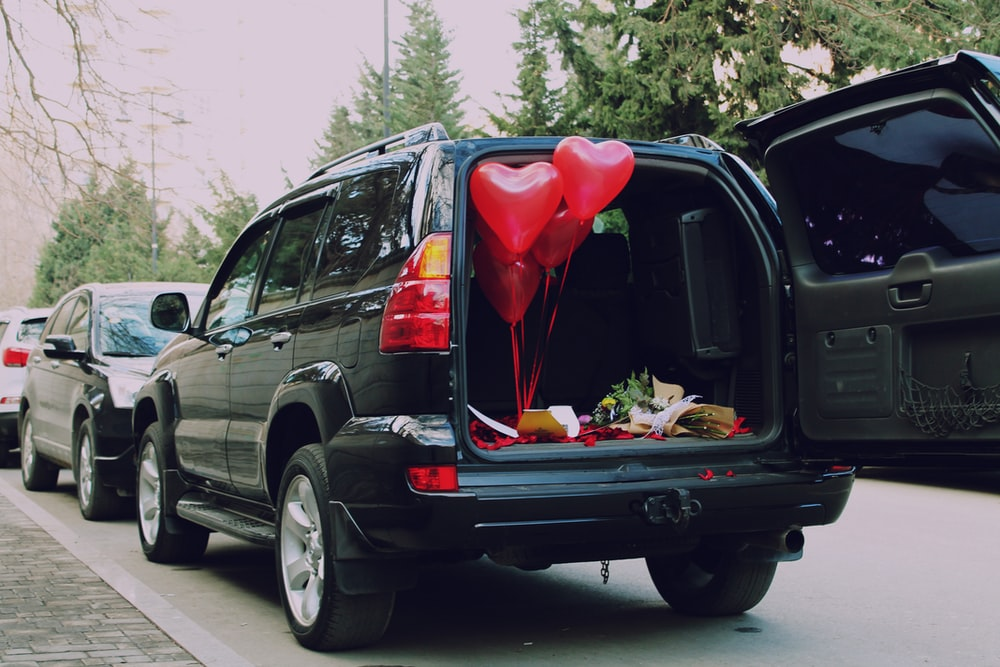 red heart balloons inside car