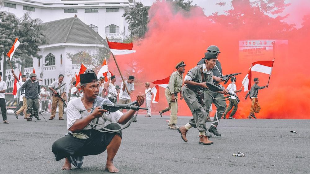 man holding gun during daytime