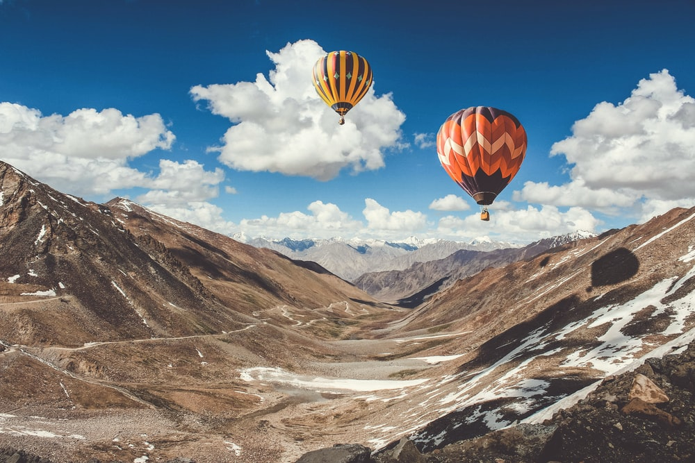 two hot air balloons floating