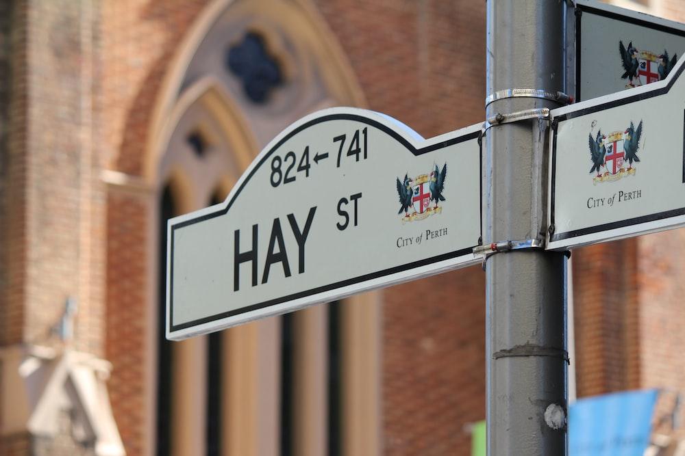 gray Hay St. signage at daytime