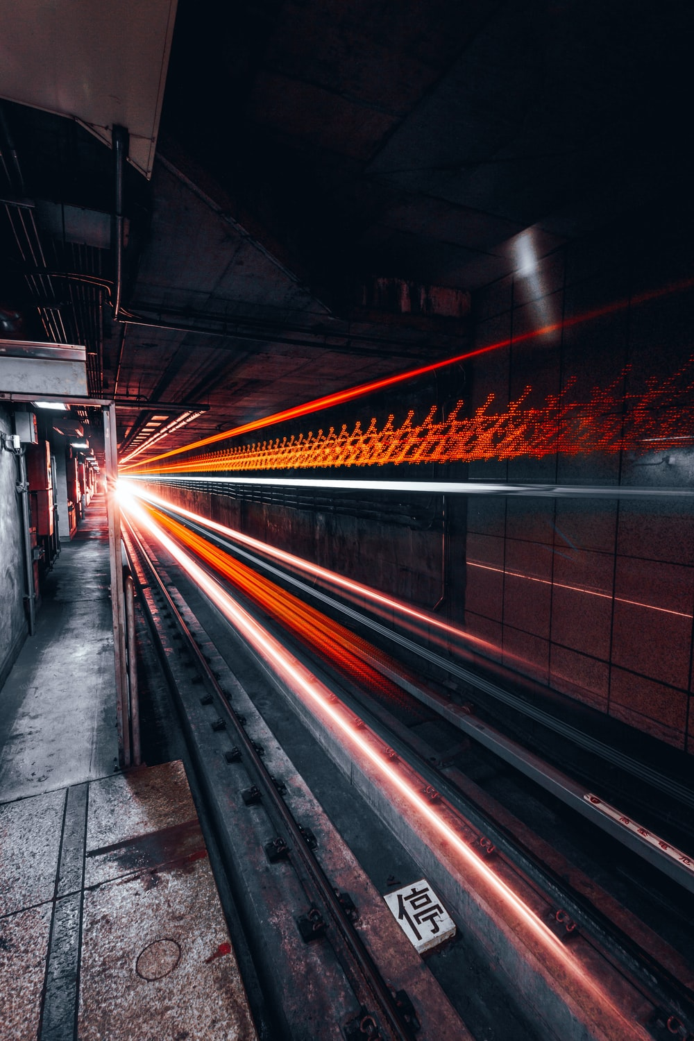 red and gray light crossing on road under tunnel in timelapse photography