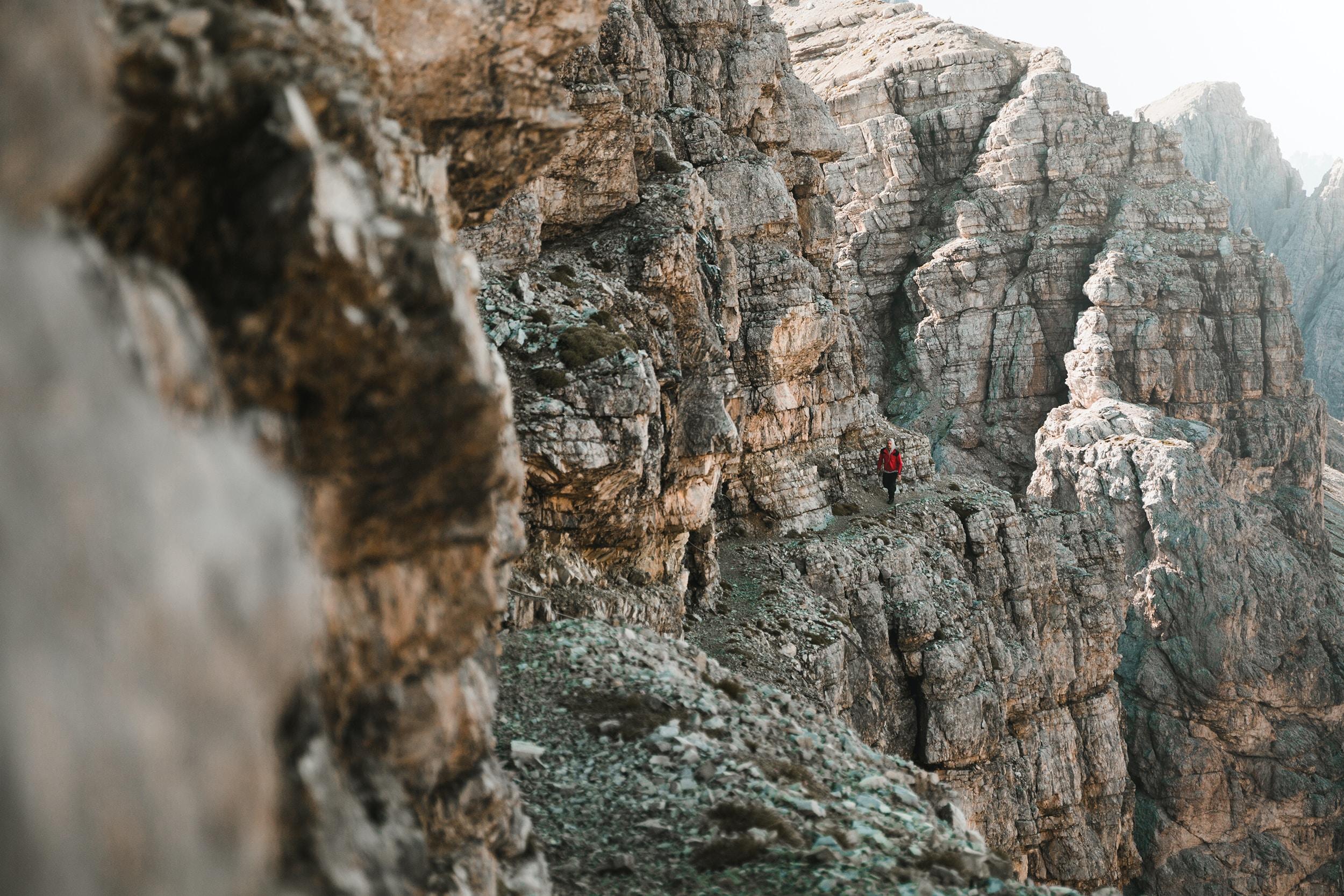 person in mountain edge