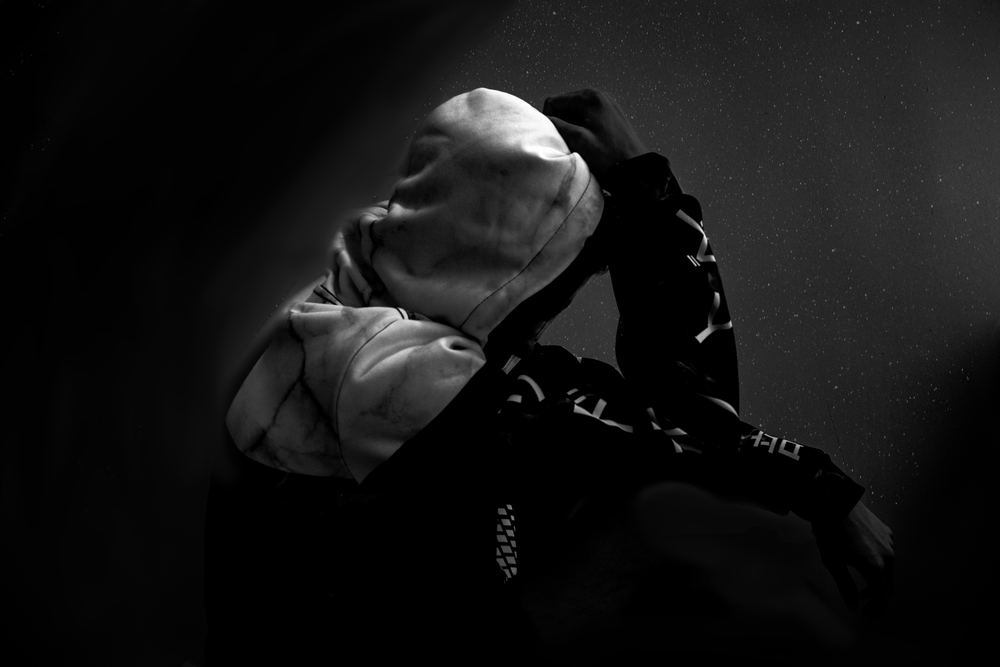 greyscale photo of person wearing hoodie