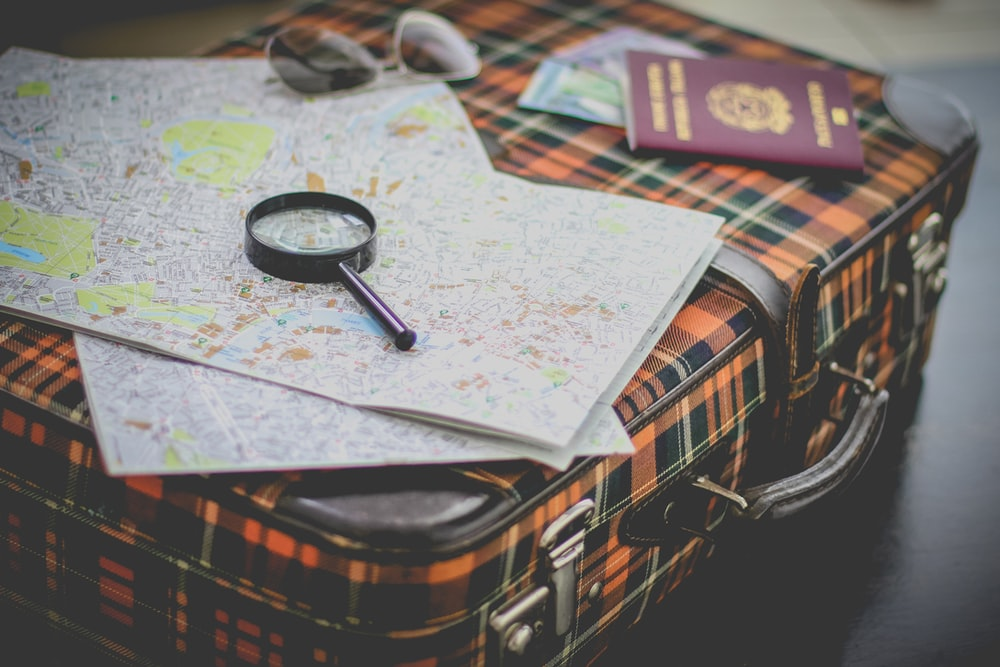 black magnifying glass on map