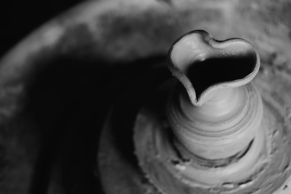 selective focus and grayscale photo of clay pot