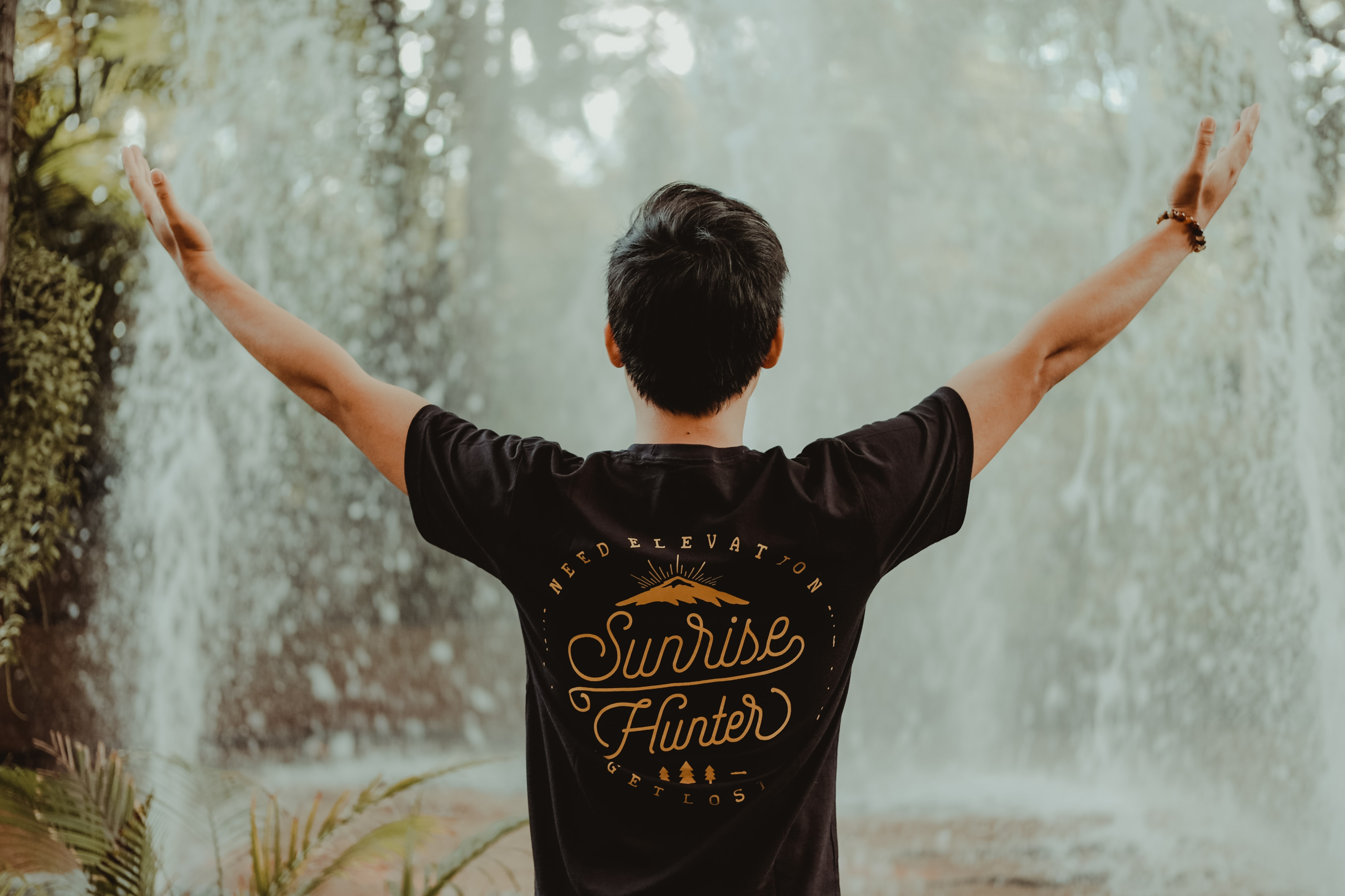 man in front of waterfalls
