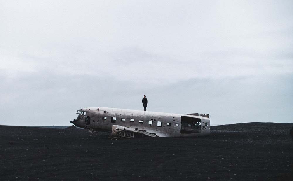 person standing on crushed plane