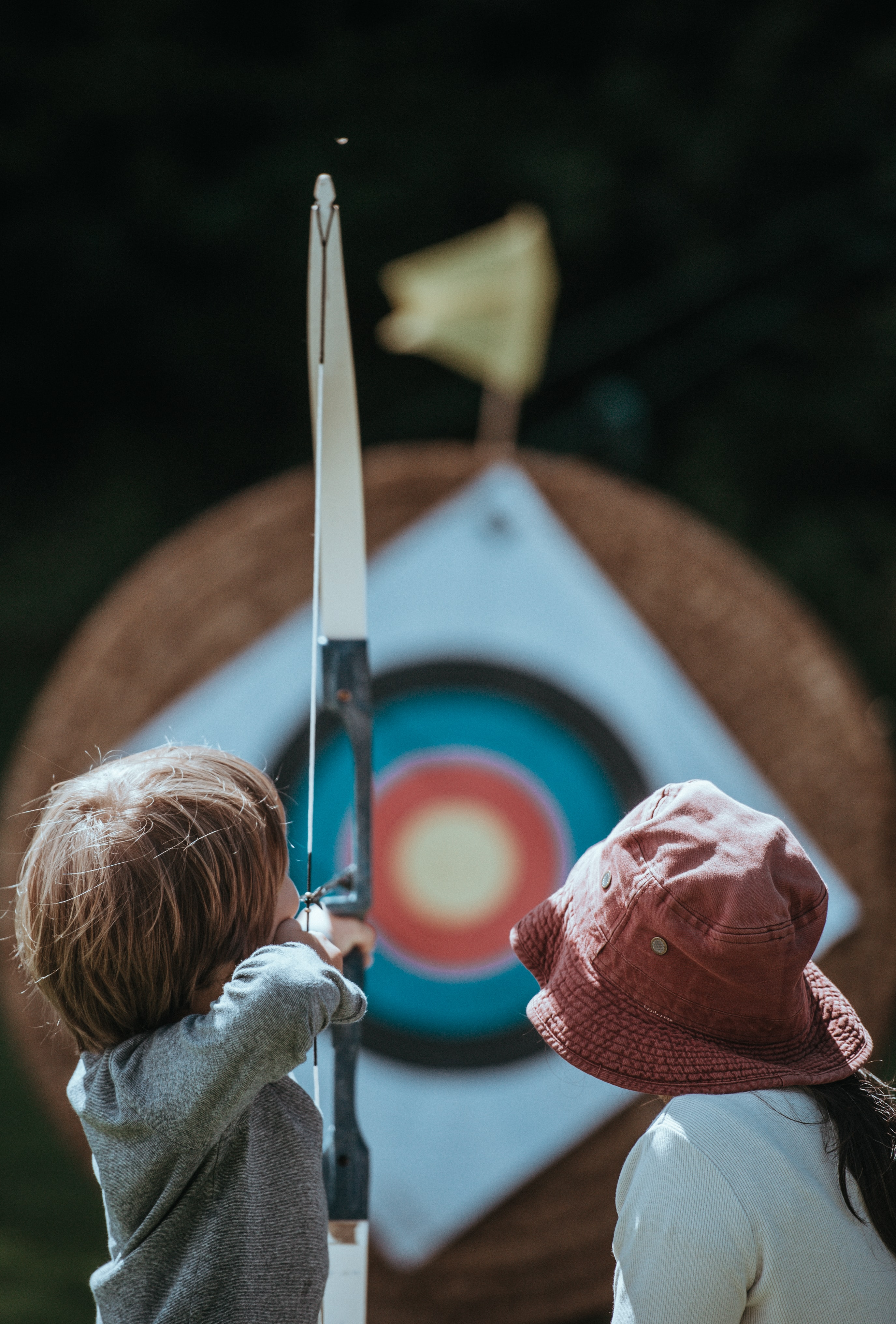 two child playing arrow