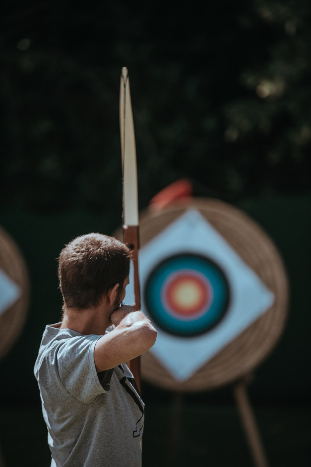 white and brown composite bow
