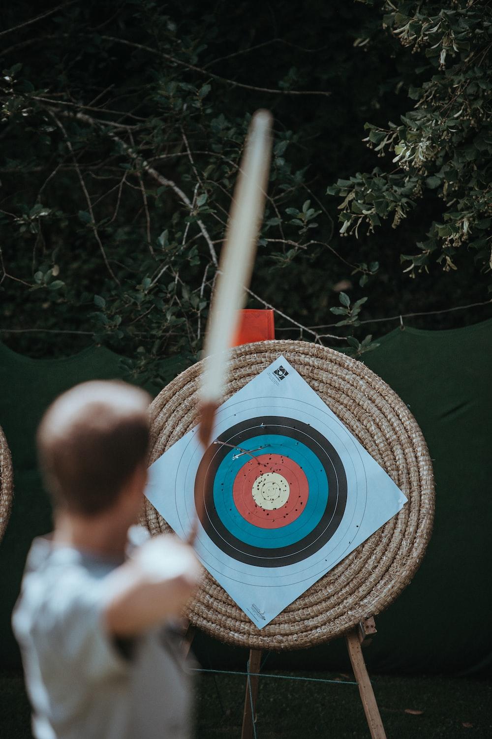 selective focus photography of arrow target