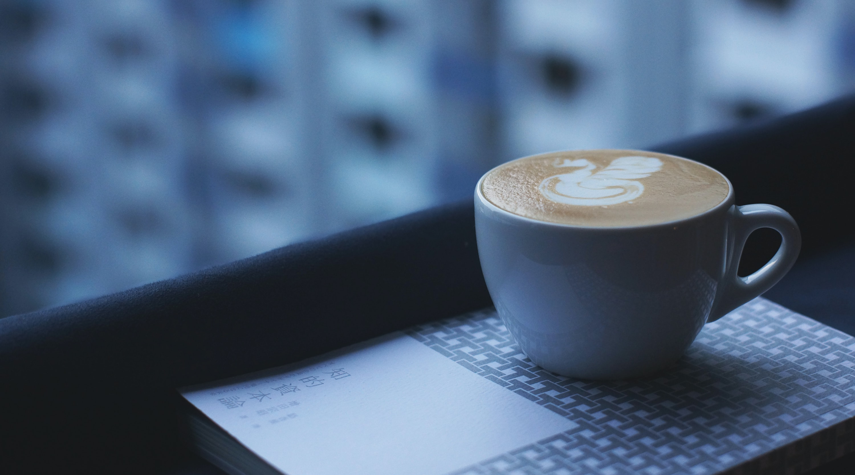 white ceramic mug with designed cappuccino