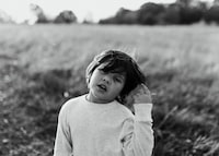 grayscale portrait photography of short-haired child