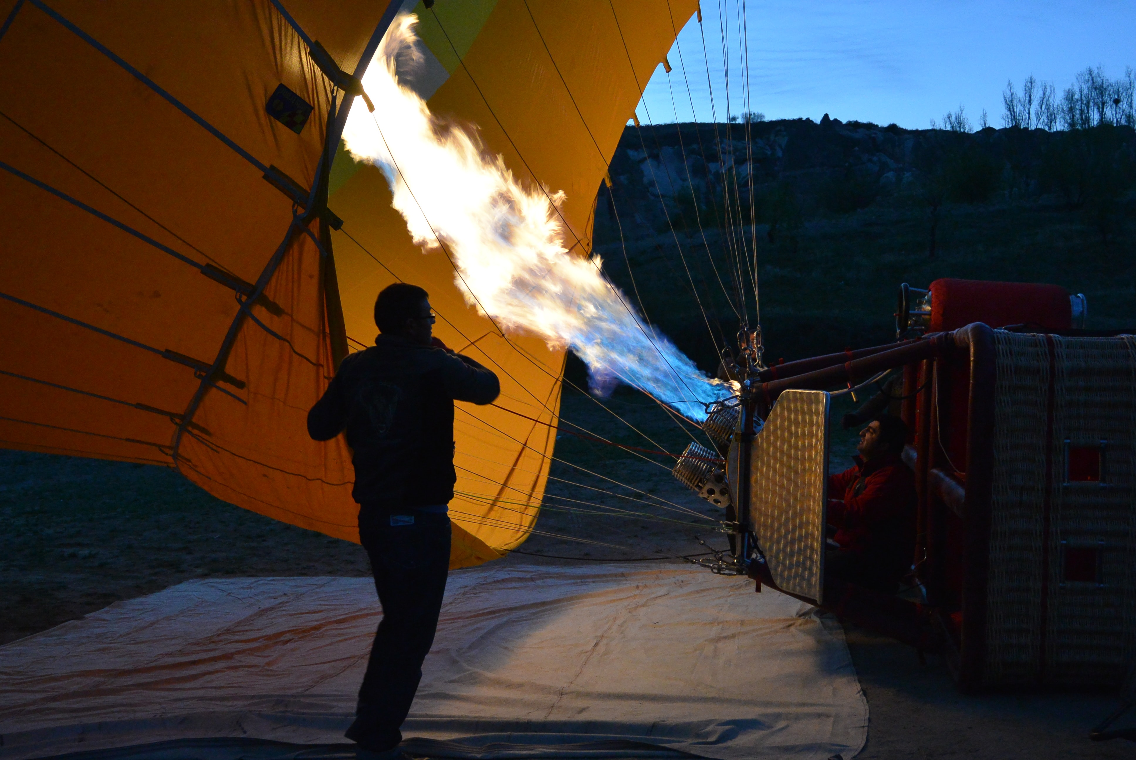 man in front of hot air balloon