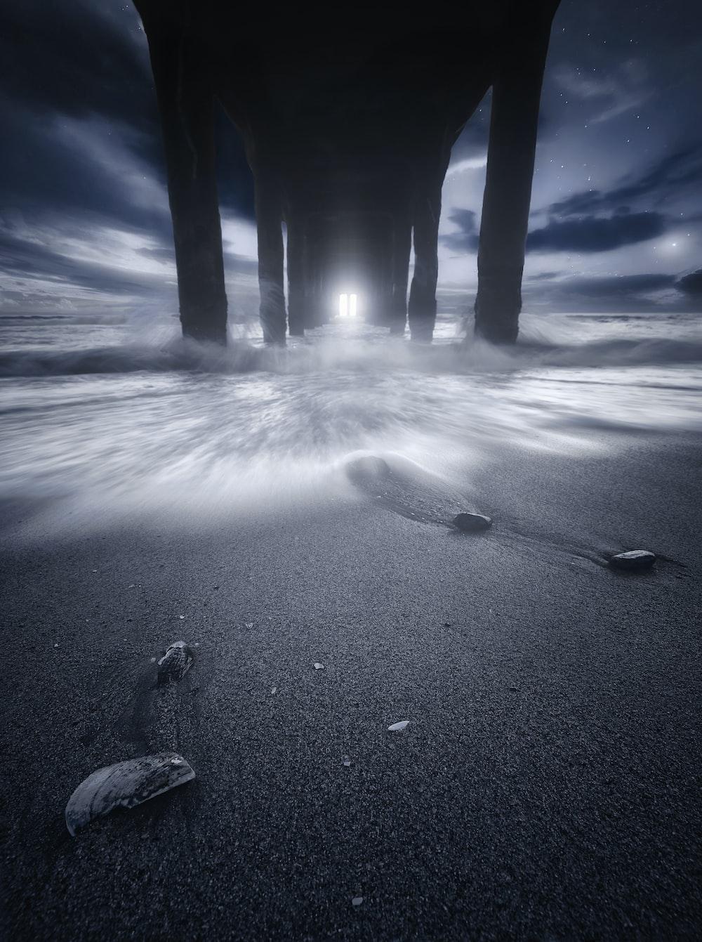 waving waters under grey wooden dock