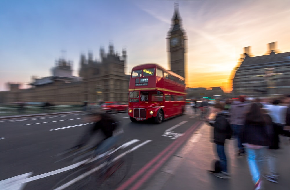 tilt shift double decker bus traveling on road