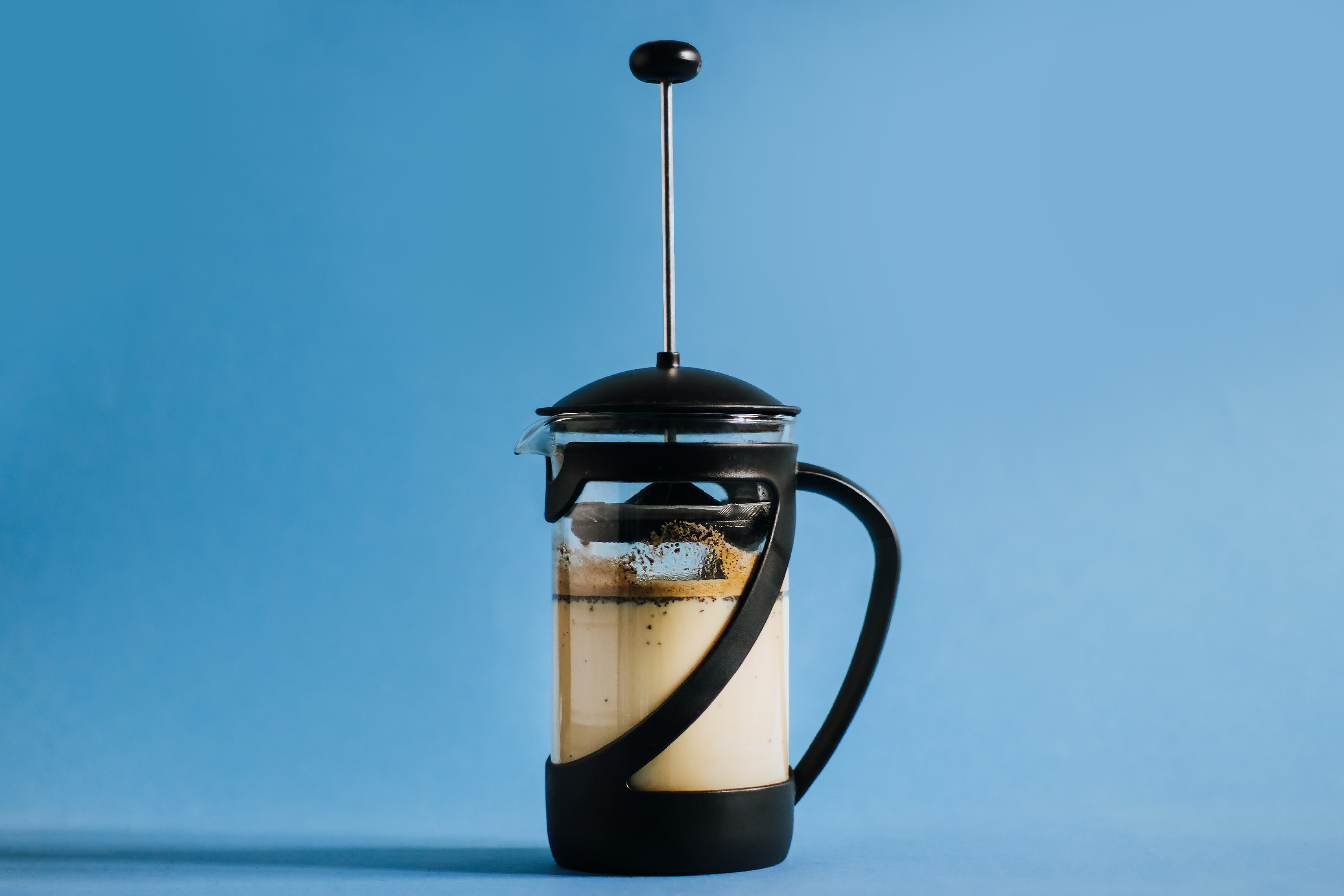 close up photo of black coffee press