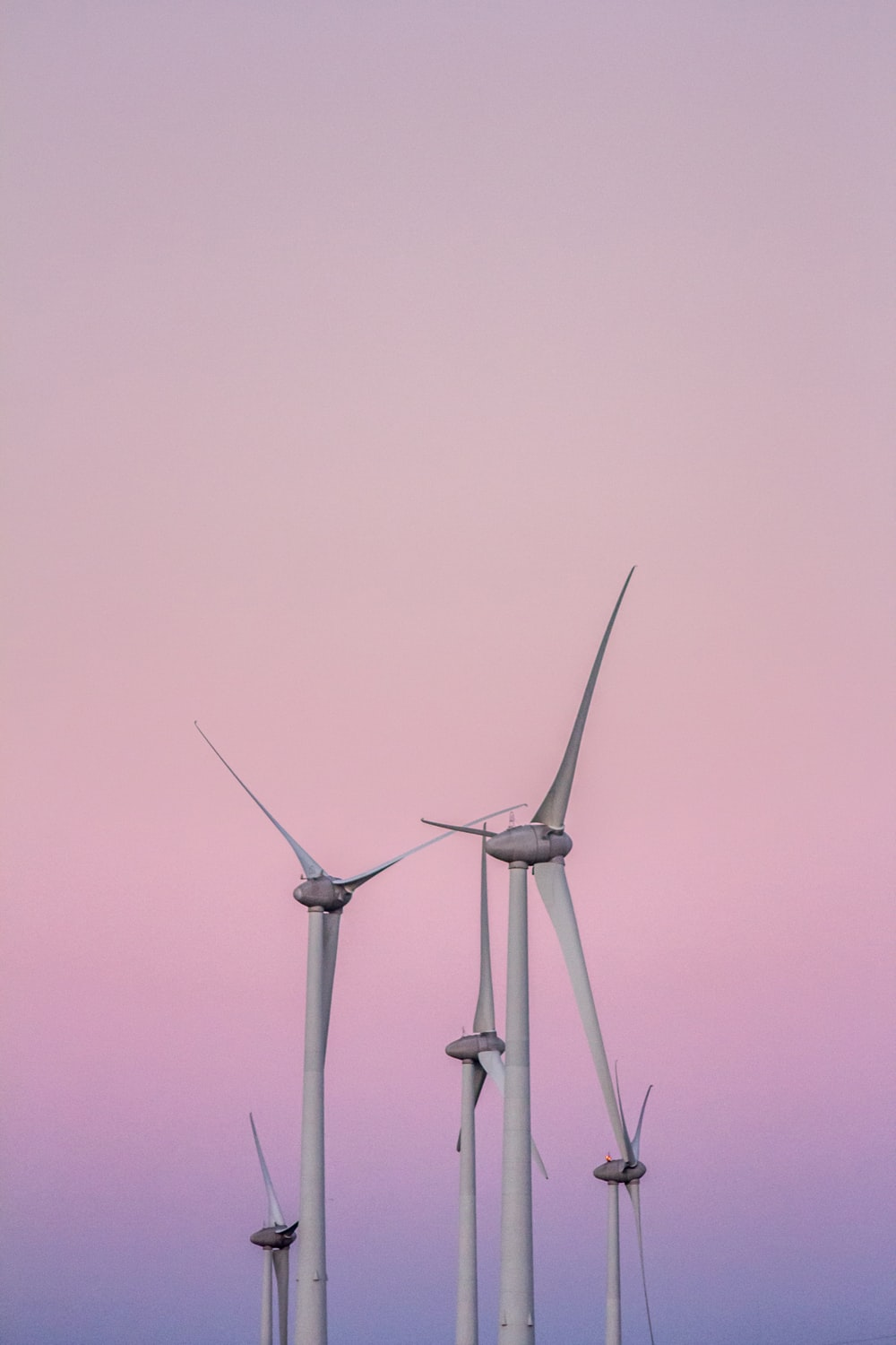 low angle photography of wind turbines