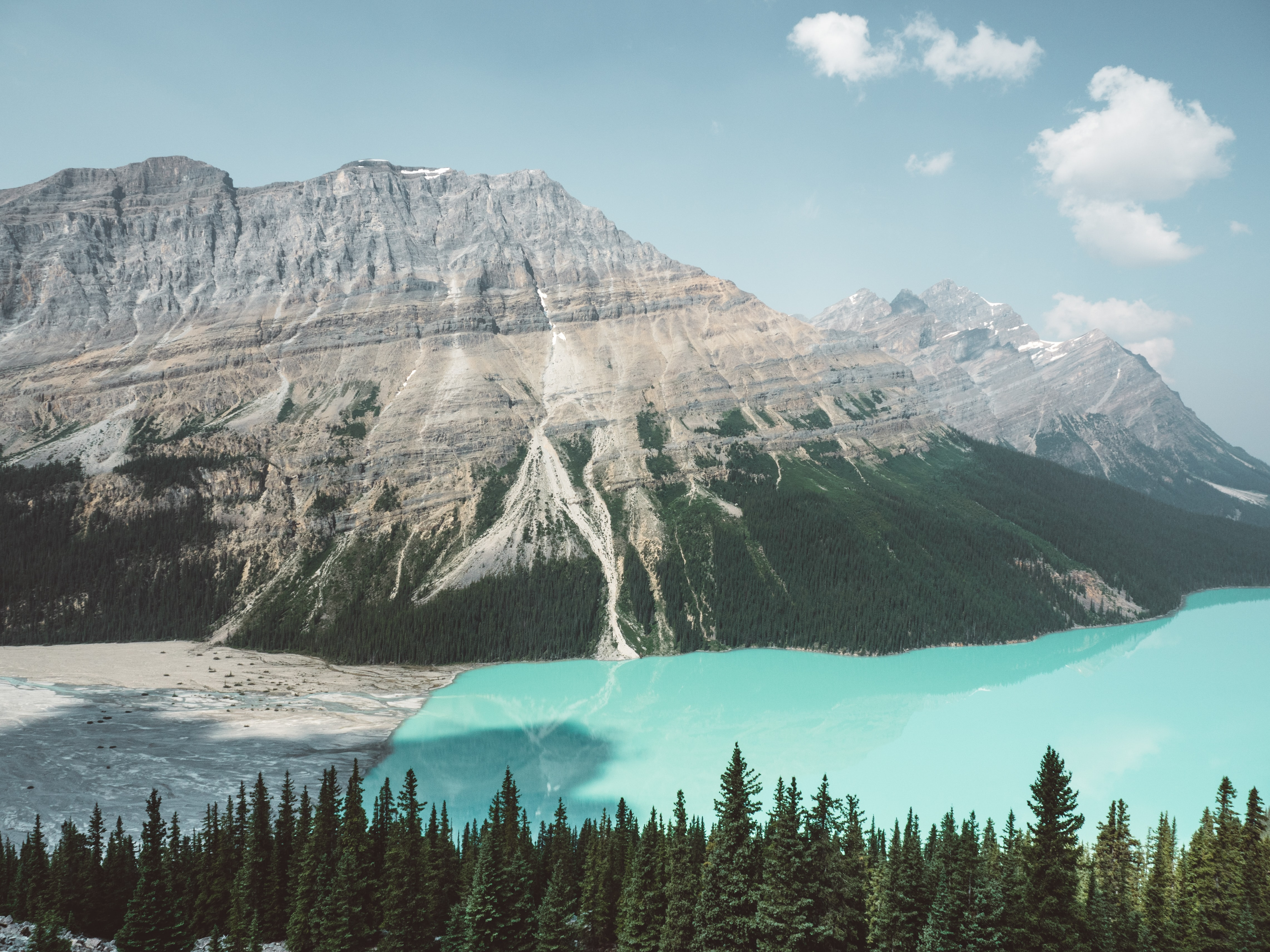 panoramic photography of mountain beside water