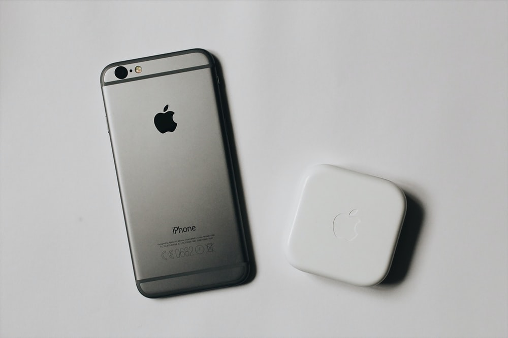 flat lay photography of space gray iPhone 6
