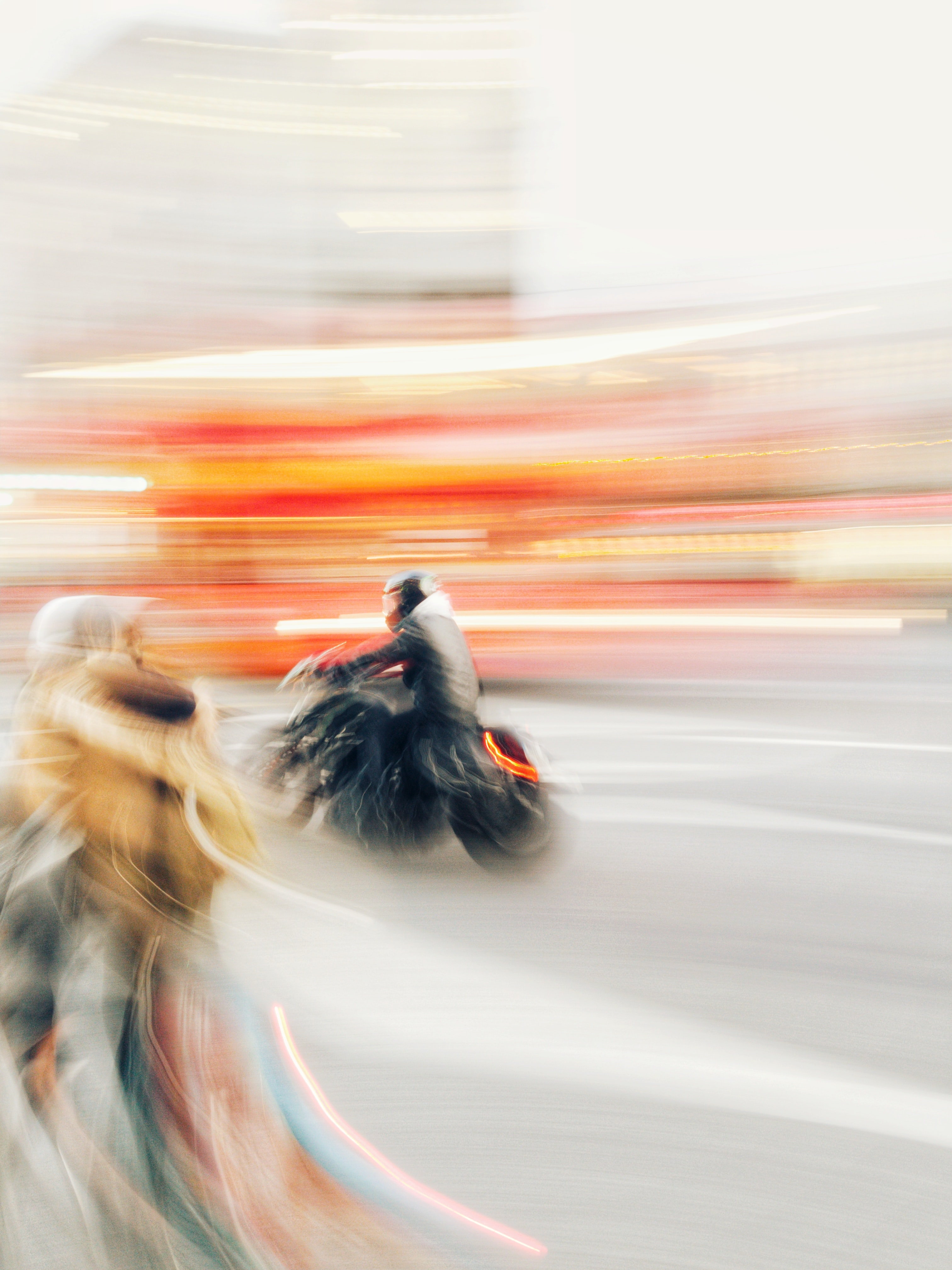 time lapse photography of man riding on motorcycle