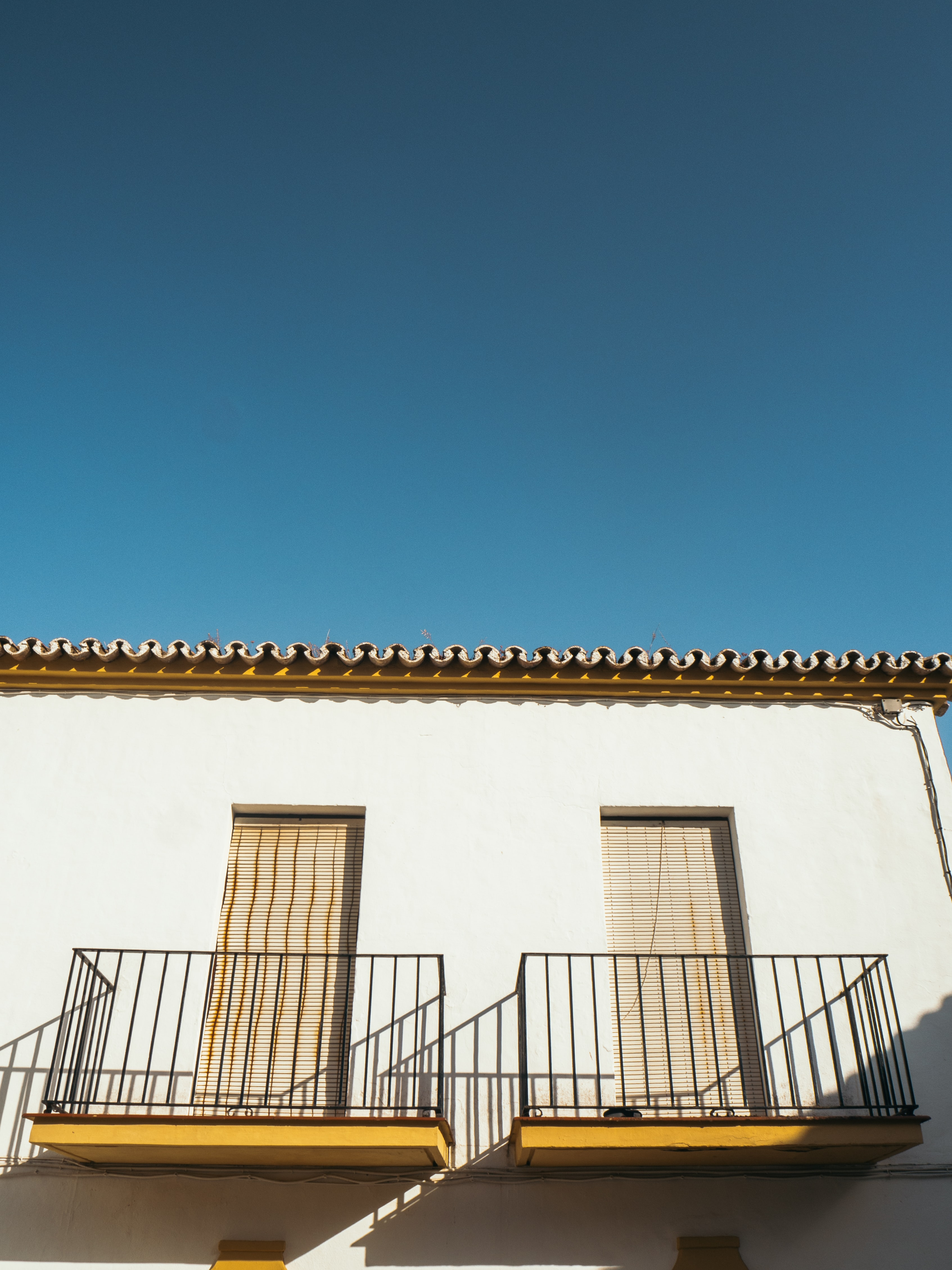 low-angle photo of white concrete building