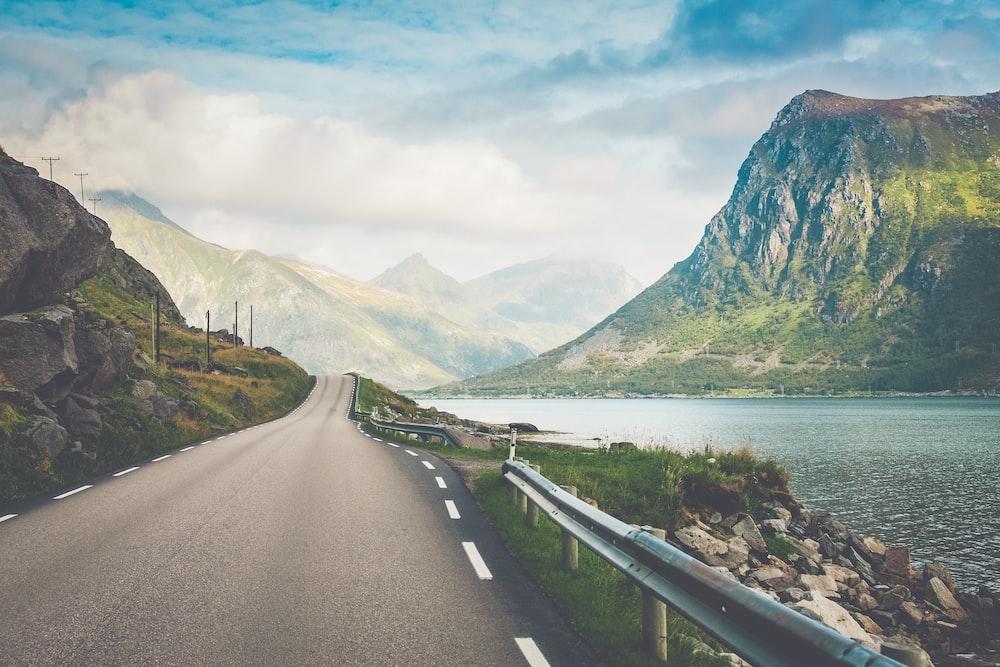 empty road beside body of water