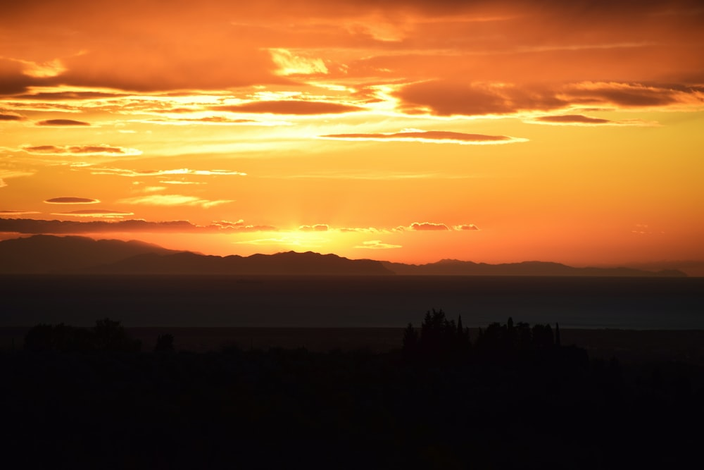 brown mountain silhouette during sunset