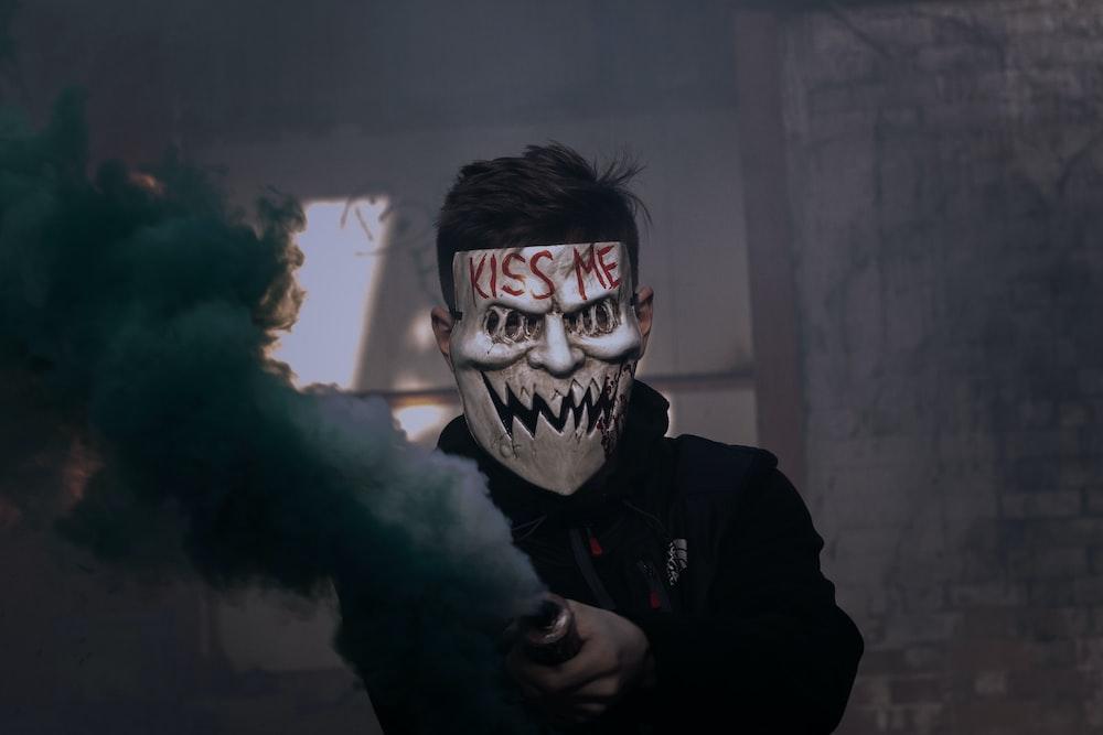 man wearing white Kiss Me-printed mask
