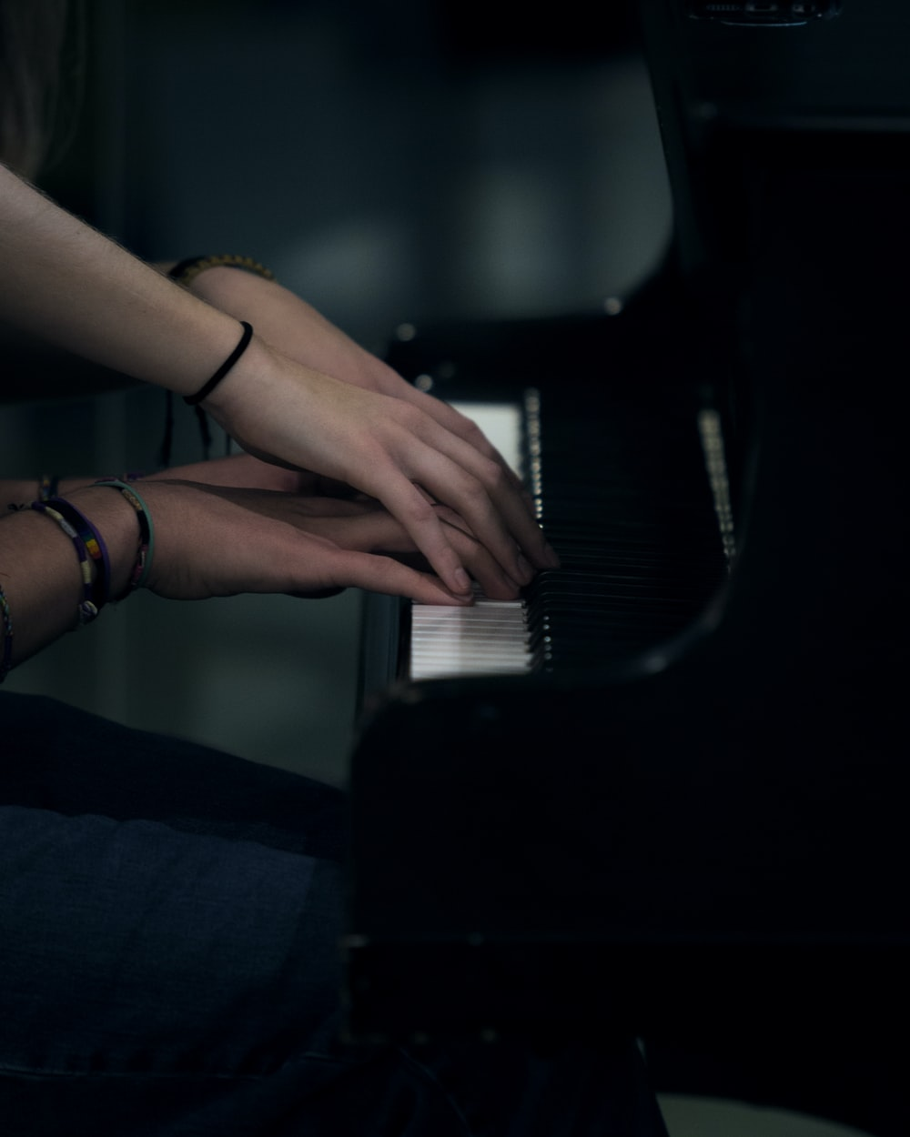 two person playing piano