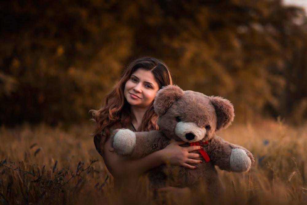 woman holding brown bear