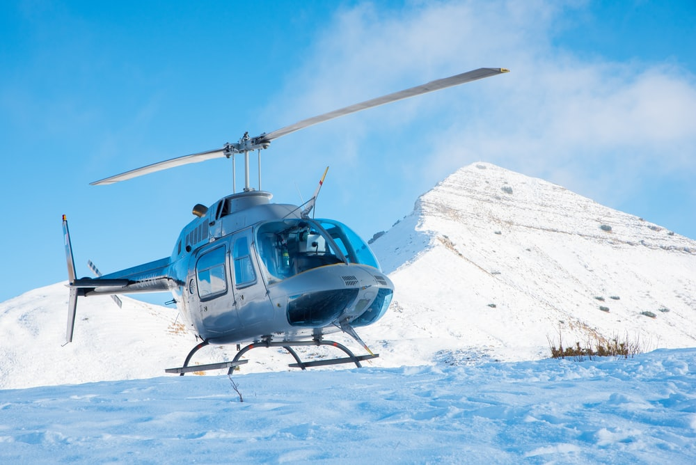 gray helicopter on mountain