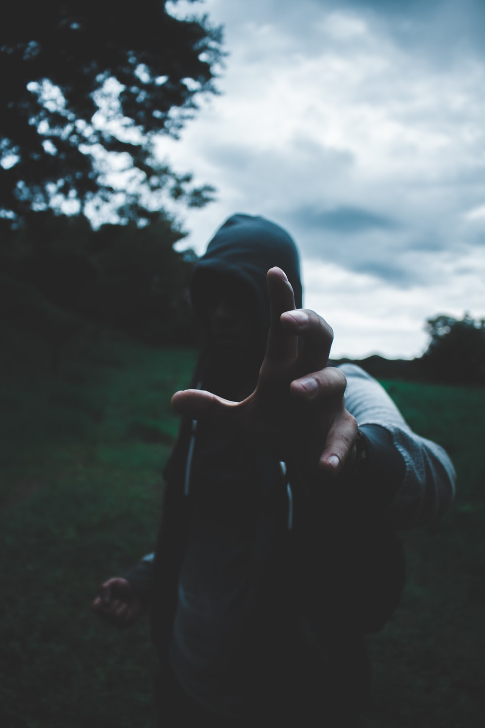 selective focus photography of man wearing hoodie