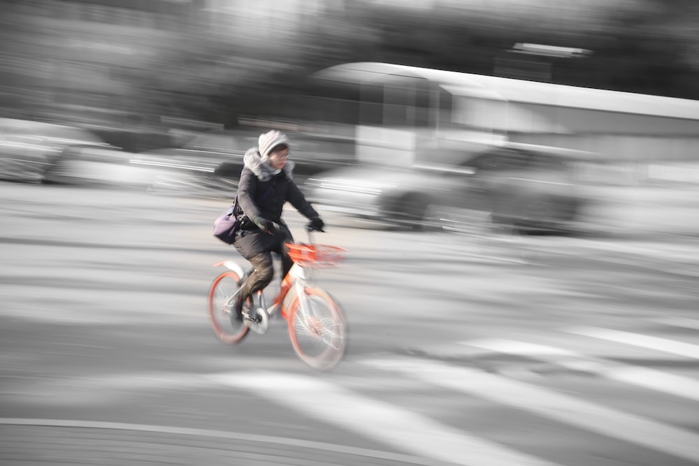 timelapses photo of woman riding bibycle