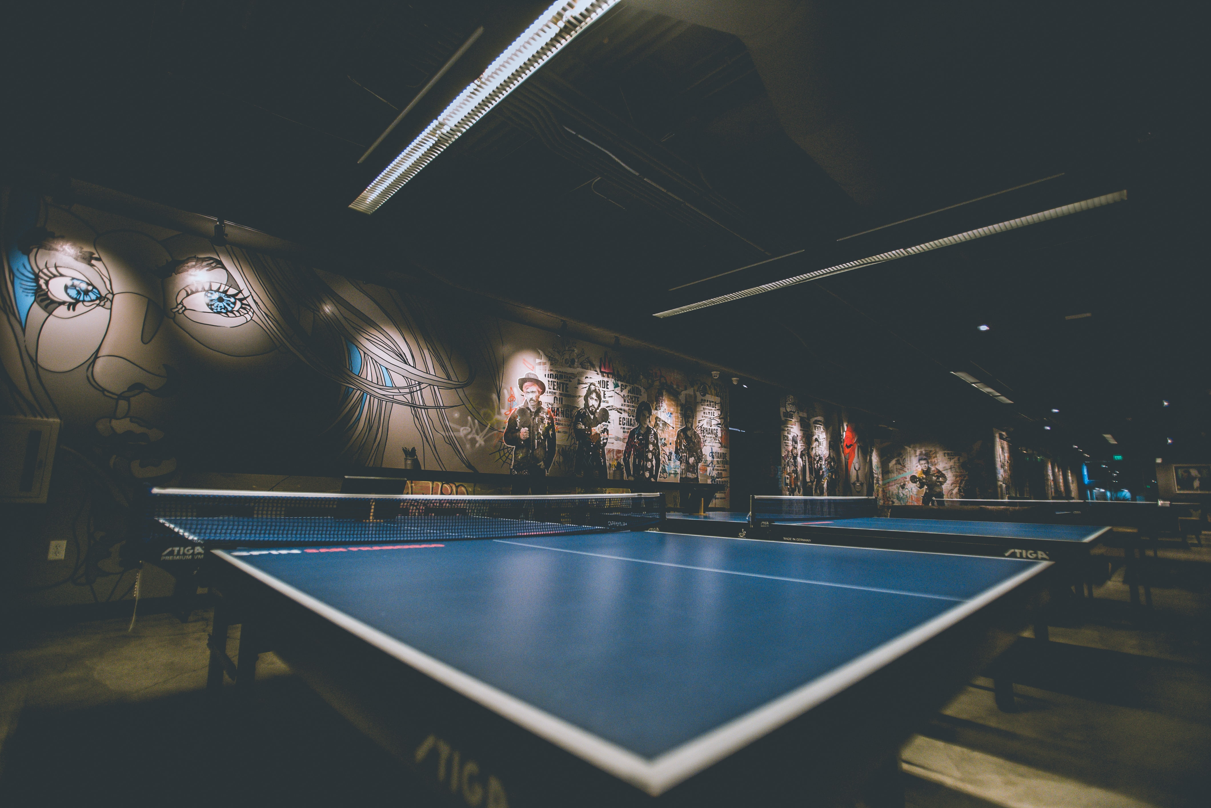 selective focus of blue ping-pong table