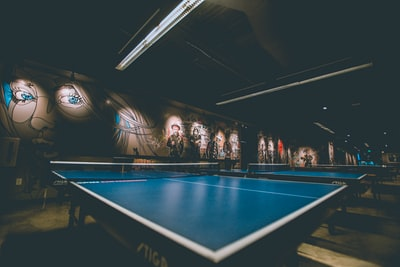 selective focus of blue ping-pong table table tennis teams background