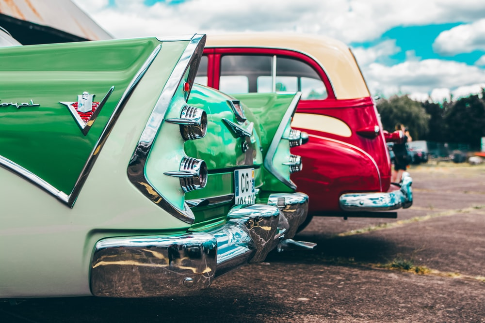 red, green, and beige cars