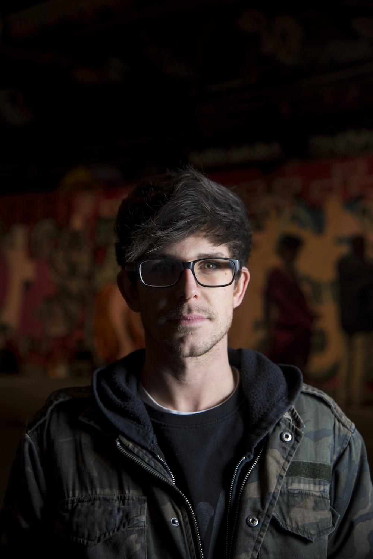 f05d9a2f674 man standing wearing eyeglasses