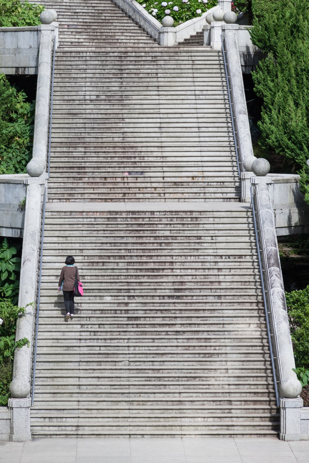 woman walking on concrete stairs