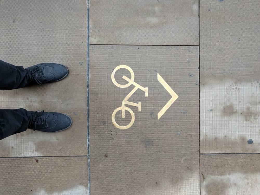 person standing on bicycle parking area