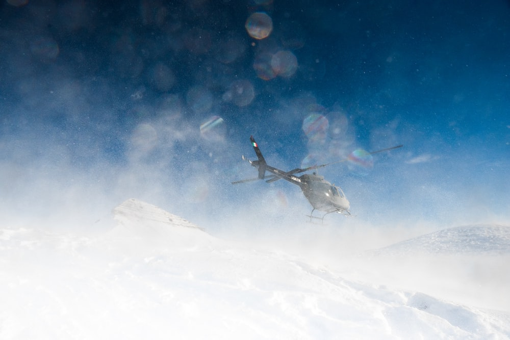 helicopter hovering on snow
