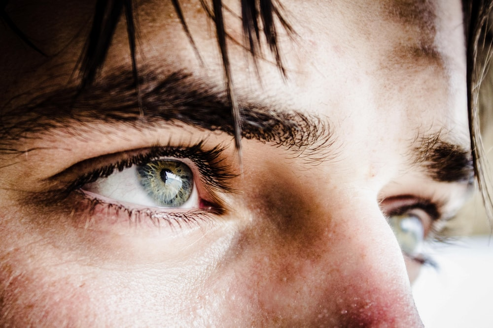 close up photo of gray-eyed man