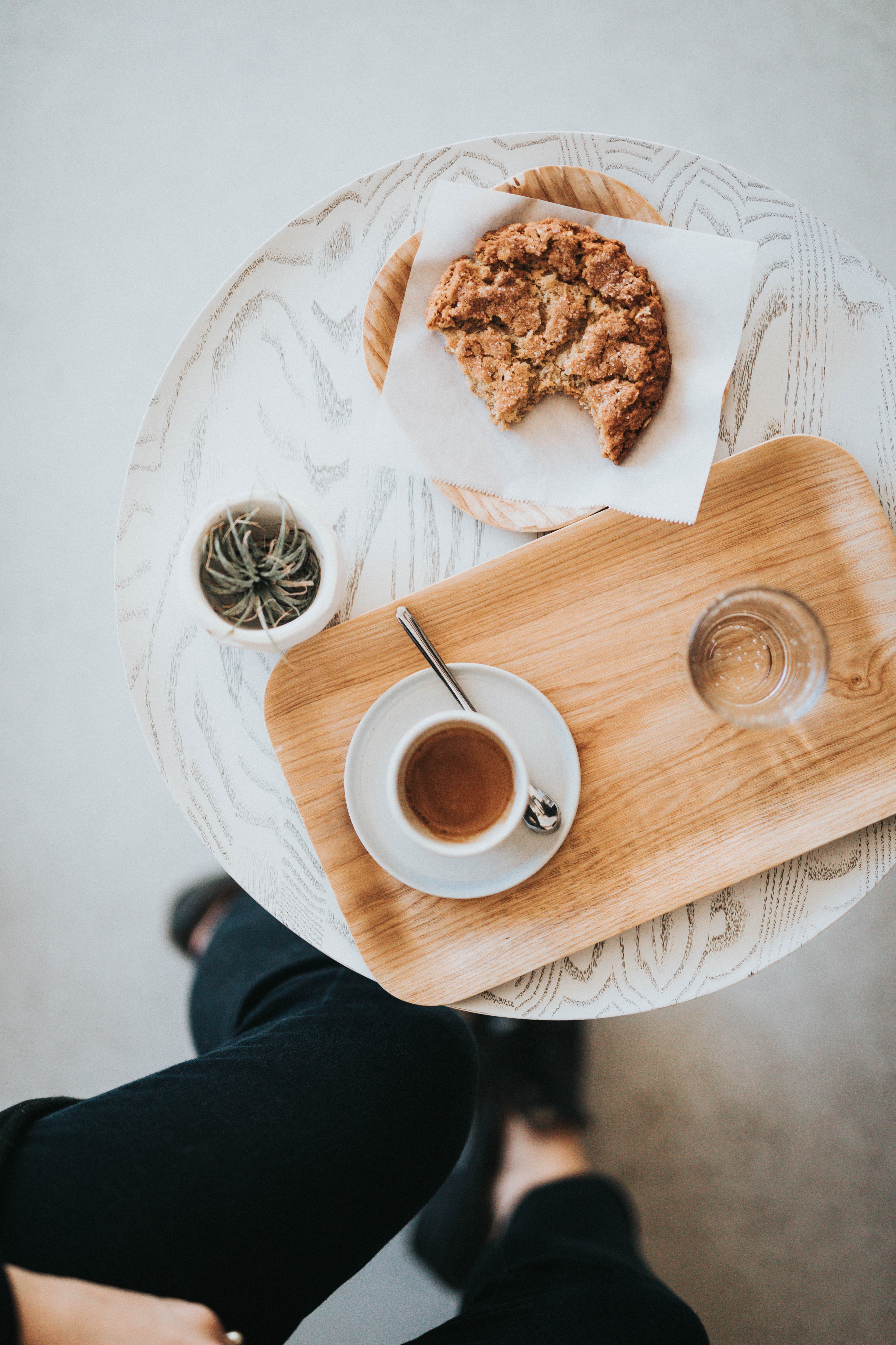 flat-lay photography of pastry and liquid-filled cup on tray